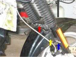 Front forks and front brake line on BMW motorcycle