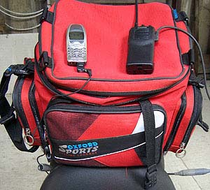 Autocom transceiver and cell phone in tank bag