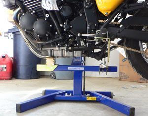 Detail view of underside of motorcycle on Bike-Lift, using engine lifting saddle and Footpeg Mounts.