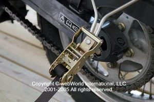 Motorcycle trailer tie down ratchet and strap
