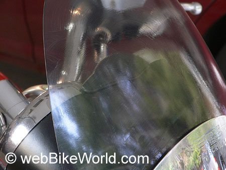 Motorcycle windshield with All Kleer applied and drying.