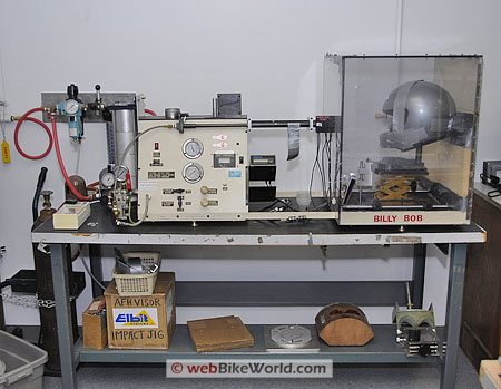 An impact testing machine for motorcycle helmet visors