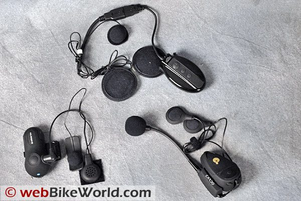 Clockwise from top: IMC Camos; Cardo Scala Rider TeamSet; Interphone