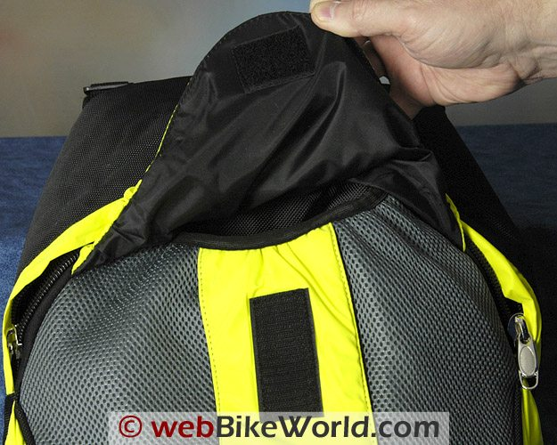 Road Sack Backpack - Outer pocket cover attaches to the body of the backpack with Velcro; elastic is used in the seams.