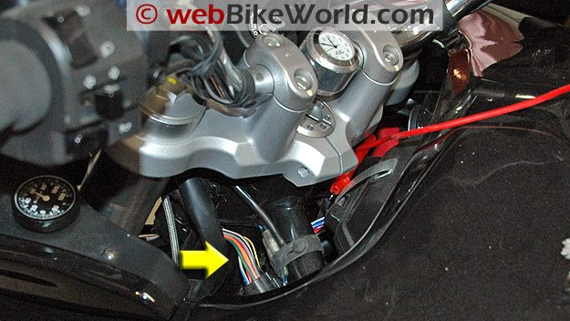 Arrow indicates the wiring harness in the Multistrada.