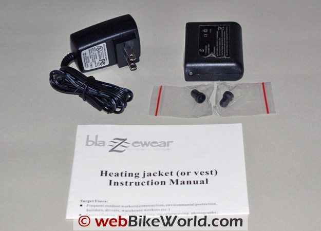 Clockwise from top left: Blazewear Heated Vest battery charger, battery, protection plugs, owner's manual.