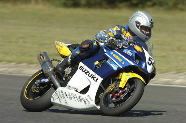 Motorcycle racer using a Reevu MSX1 helmet