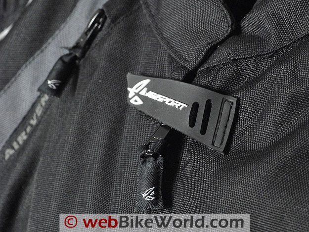 Close-up of zipper pulls and neck closure on the AGV Sport Tempest Jacket.