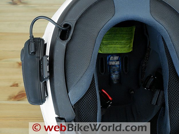 Bottom view of Interphone F4 mounted on motorcycle helmet.