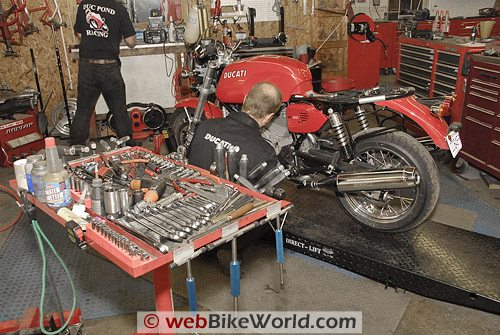 Donnie Unger, Duc Pond Motosports, working on the bike.
