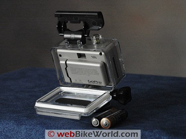 The GoPro Wide in its waterproof housing, with two AAA batteries in the foreground.