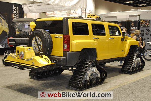 How about a Hummer snow vehicle, with...what the heck is that on the back?