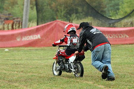 Kids Motocross Training - Instructor Pushing