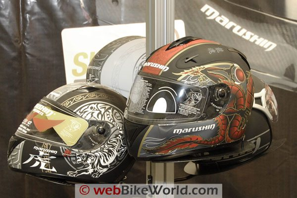 Some Marushin full-face helmets with Japanese-inspired graphics.