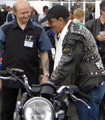 Vintage Triumph rider meets modern Triumph employee