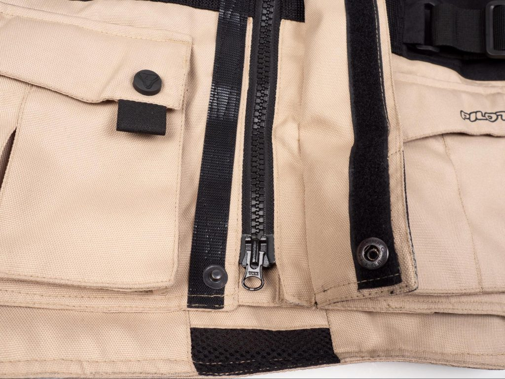 Pilot Motosport Elipsol Air Closeup of Bottom Zipper And Button Clasp