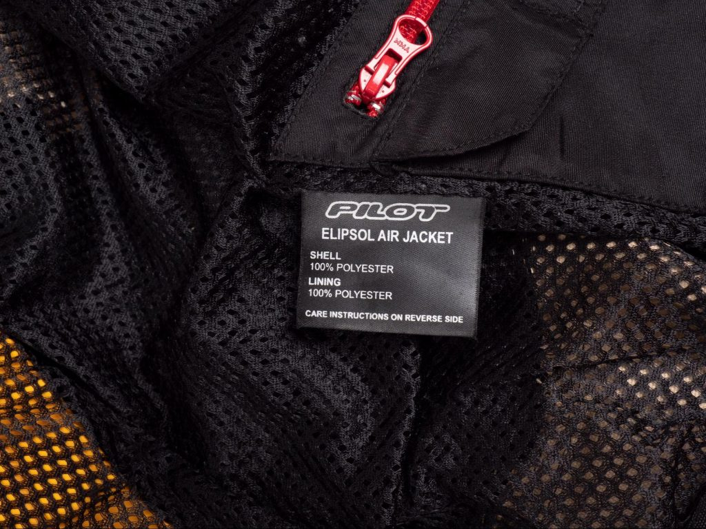 Pilot Motosport Elipsol Air Jacket Closeup of Inner Jacket Product Wash Tag - Shell and Lining are 100% POLYESTER