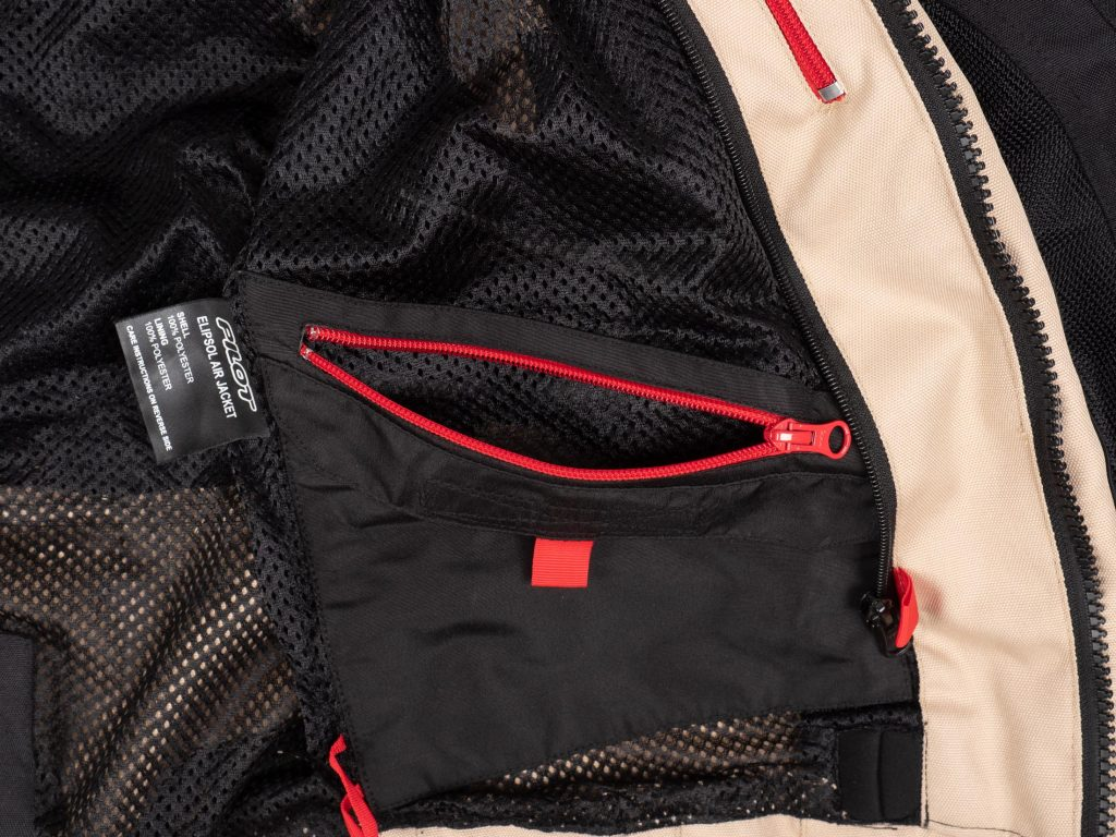 Pilot Motosport Elipsol Air Jacket Closeup of Inner Pocket with Red Zipper Open