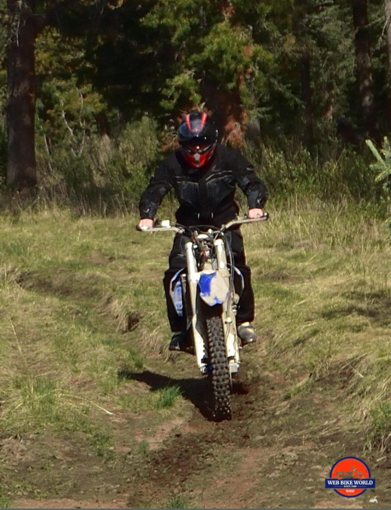 Action Shot of Rukka ROR ride on Dirt Path in Forest