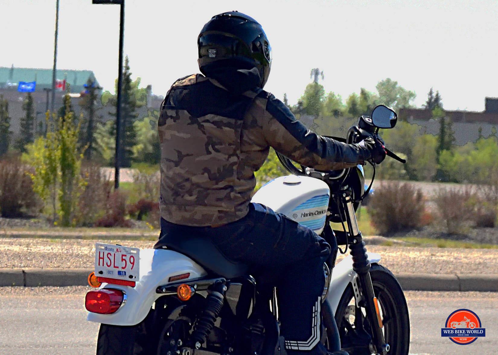 Clymer Repair Manual Image Gallery. Rider in Camo on top Harley Davidson  Motorcycle