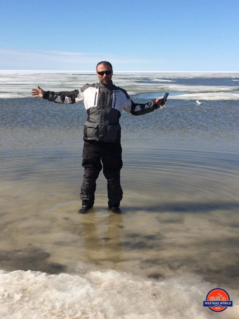 In Tuktoyaktuk wearing Joe Rocket Canada and Sidi riding gear in the Arctic Ocean.