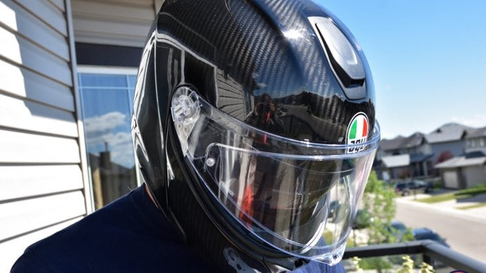 The AGV Sportmodular Carbon helmet on my head looking down.