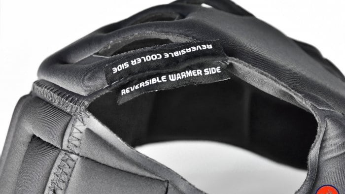 AGV Sportmodular Carbon Gloss helmet crown comfort liner tag showing reversibility instructions.