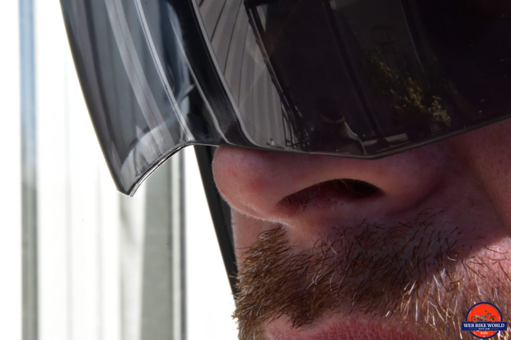 The sun lens on the AGV Sportmodular Carbon helmet shown touching my nose.
