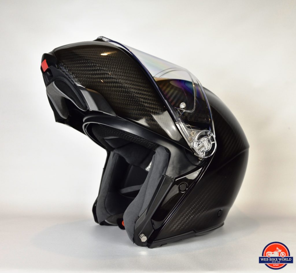AGV Sportmodular Carbon Gloss helmet chinbar raised, sun lens lowered from the left side.
