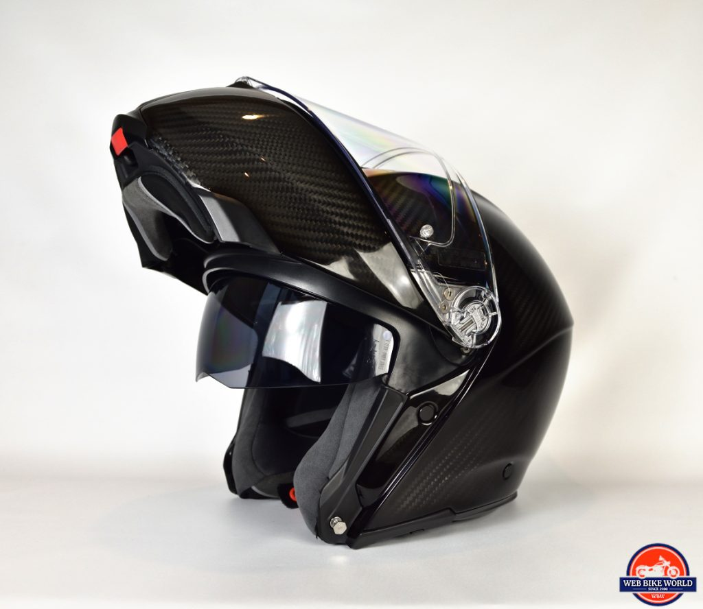 AGV Sportmodular Carbon Gloss helmet chinbar raised and sun lens retracted.