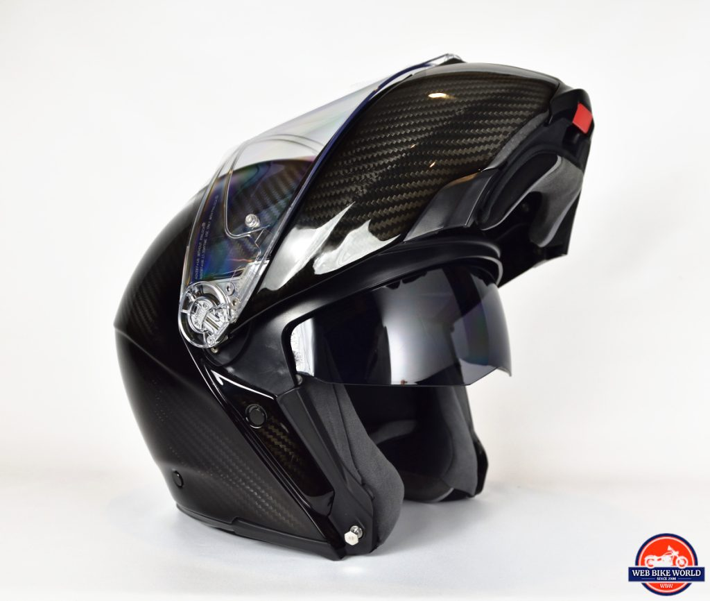AGV Sportmodular Carbon Gloss helmet with chinbar raised and sun lens lowered.