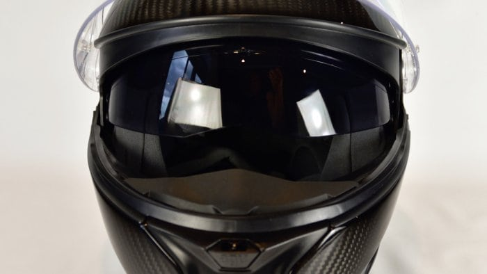 AGV Sportmodular Carbon Gloss helmet with chinbar lowered and sun lens lowered.