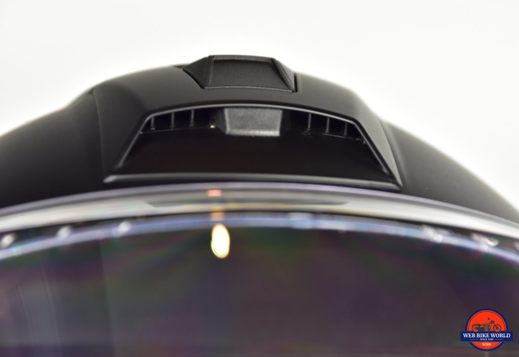 AGV Sportmodular Carbon Gloss helmet top vent open closeup.