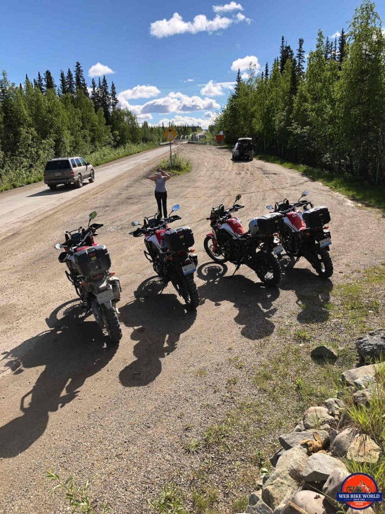 Tammy taking a group photo at the beginning of the Dempster Highway.