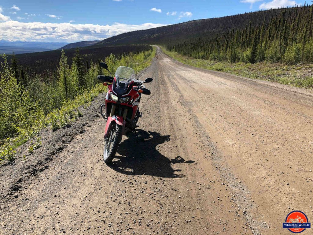 An Africa Twin overlooking the Ogilvie Ridge on the Dempster Highway.