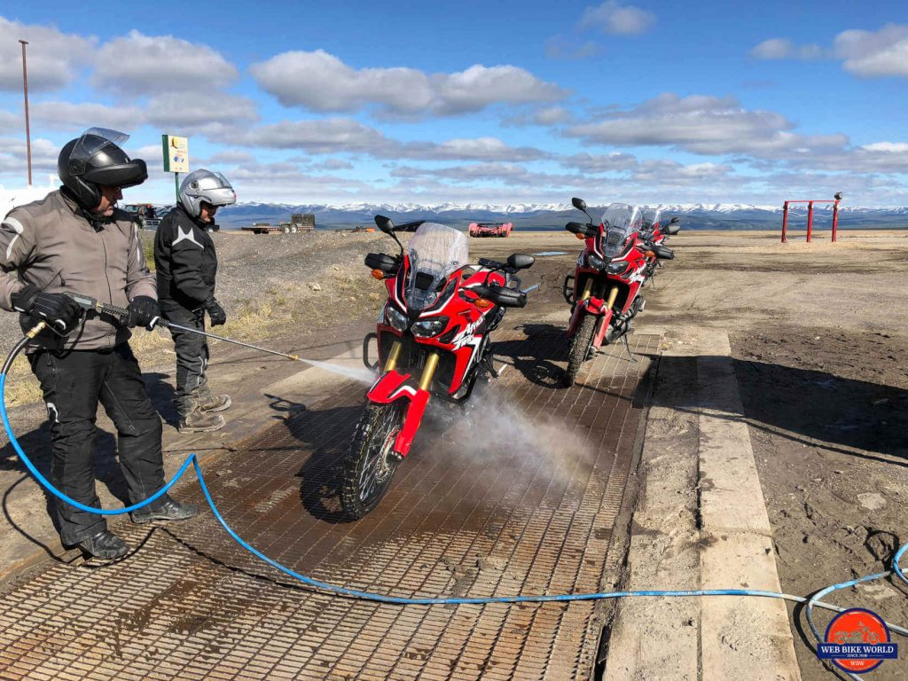 Washing the Africa Twins at the Eagle Plains Motel on the Dempster Highway.