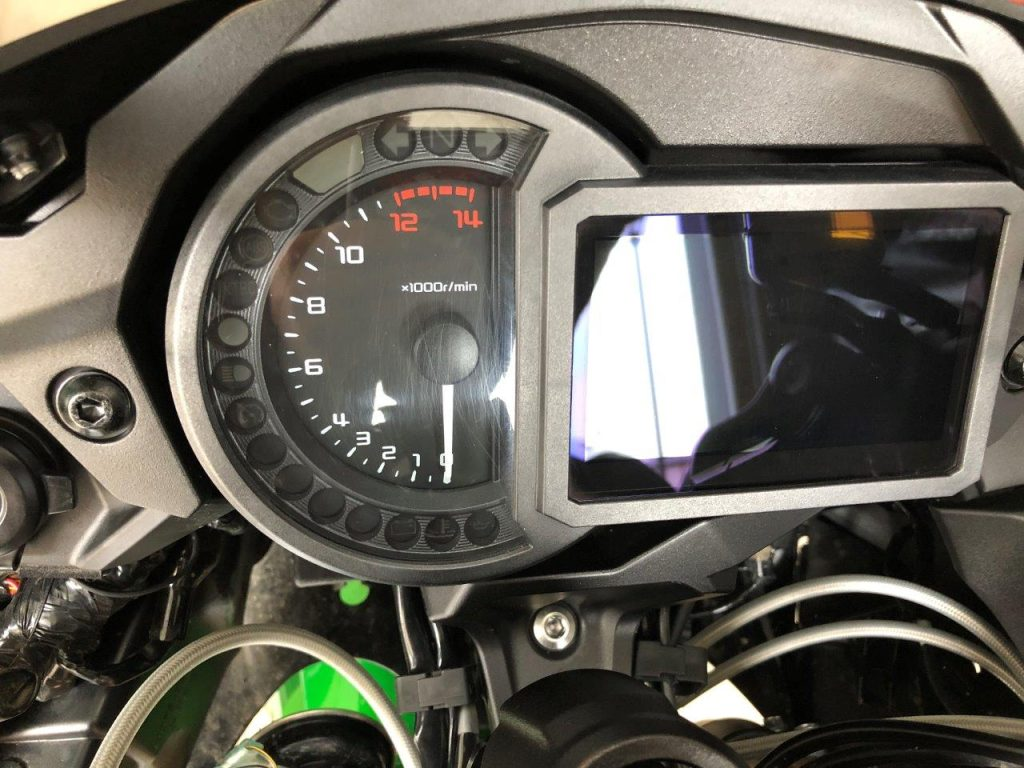Scratched tachometer cover on a 2018 Kawasaki Ninja H2SXSE.