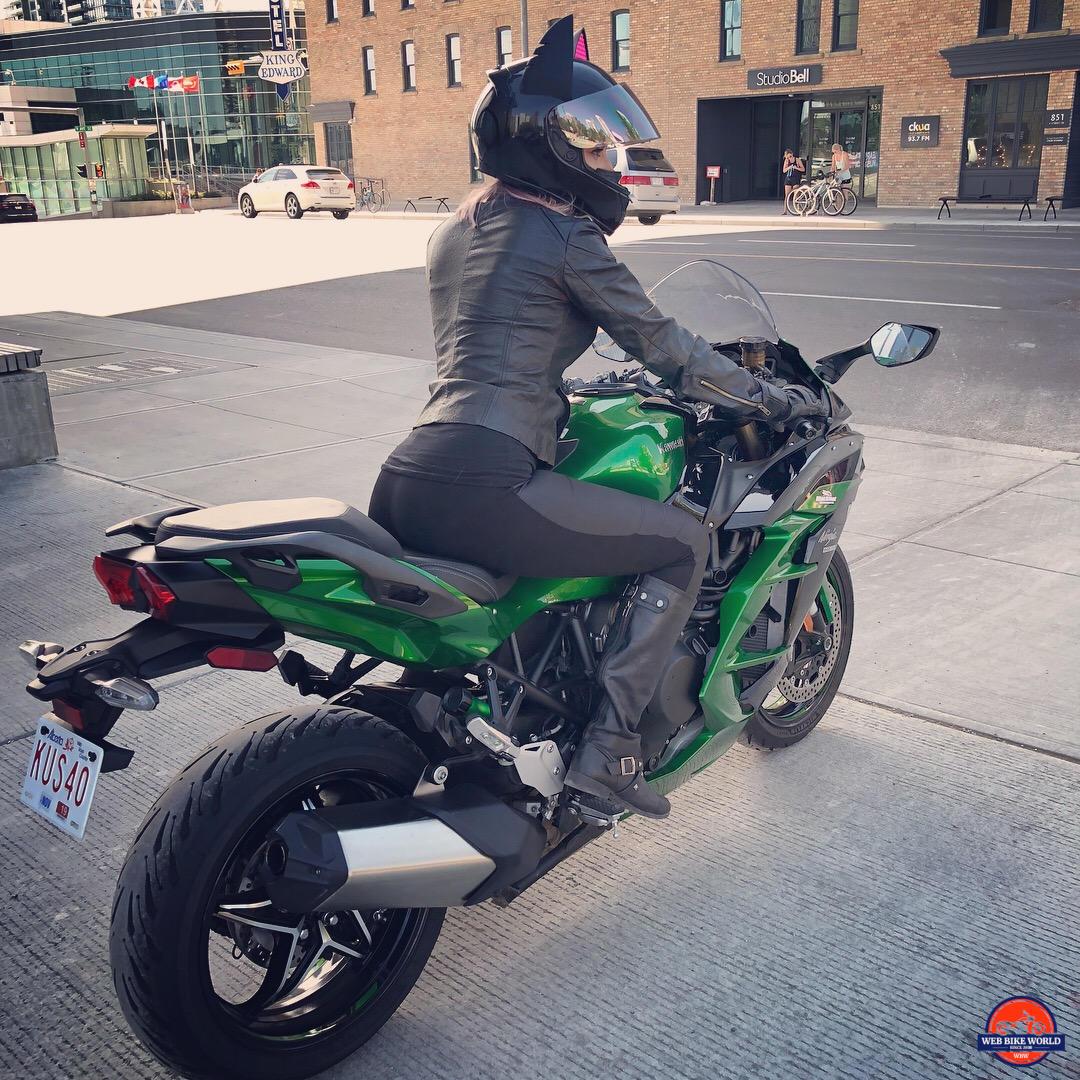 Catwoman riding a 2018 Kawasaki Ninja H2SXSE.
