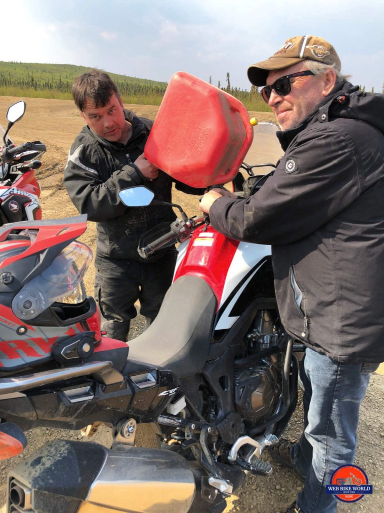 Wade and Matt fueling up the Honda Africa Twins on the Dempster Highway.