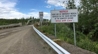 Warning sign at the beginning of the Dempster Highway, Yukon. No emergency services.
