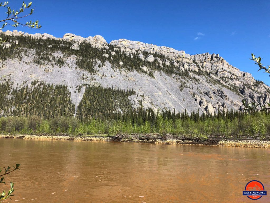 Orange coloured river on the Dempster Highway near Tombstone Park.
