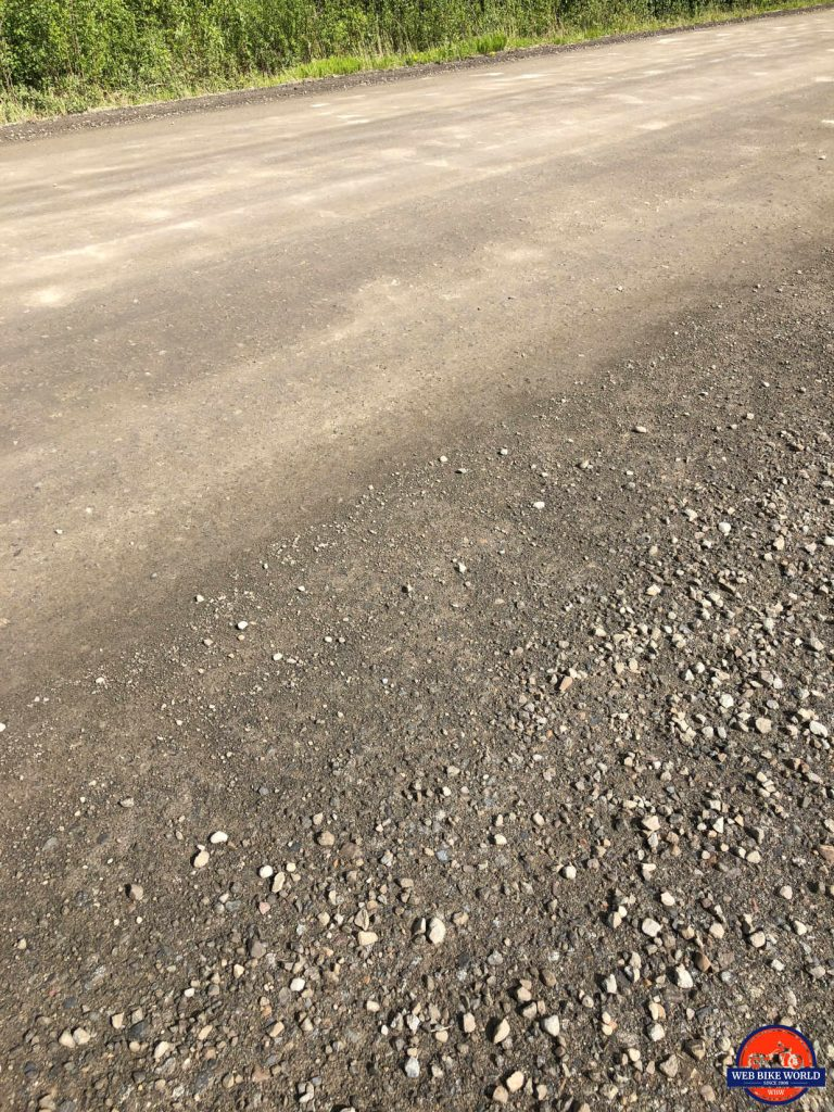 The hard packed section of the Dempster highway with potholes beginning to form.
