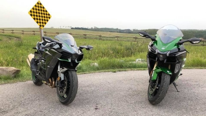 The Kawasaki H2 and H2SX SE together in a parking lot.