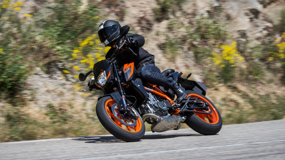 A KTM duke leans into a right turn.