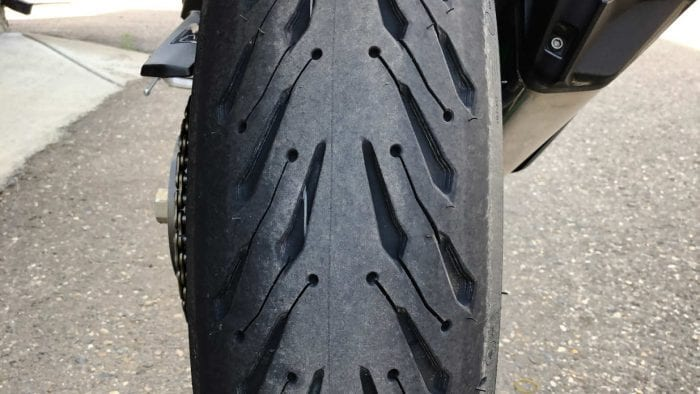 A photo of a brand new Michelin Road 5 rear tire after installation on the Ninja H2SX SE.