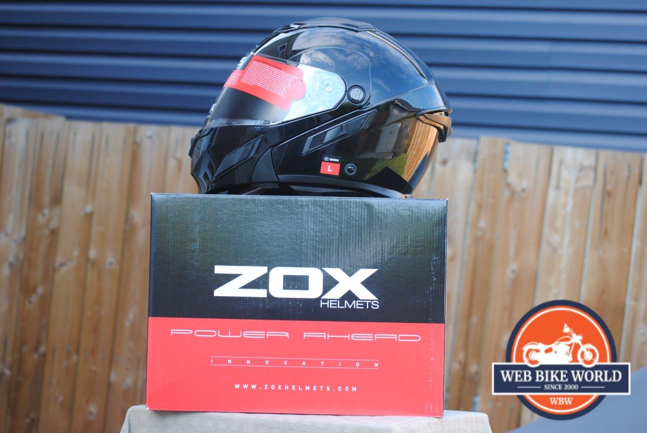 ZOX Brigade SVS Solid Helmet on top of Zox box