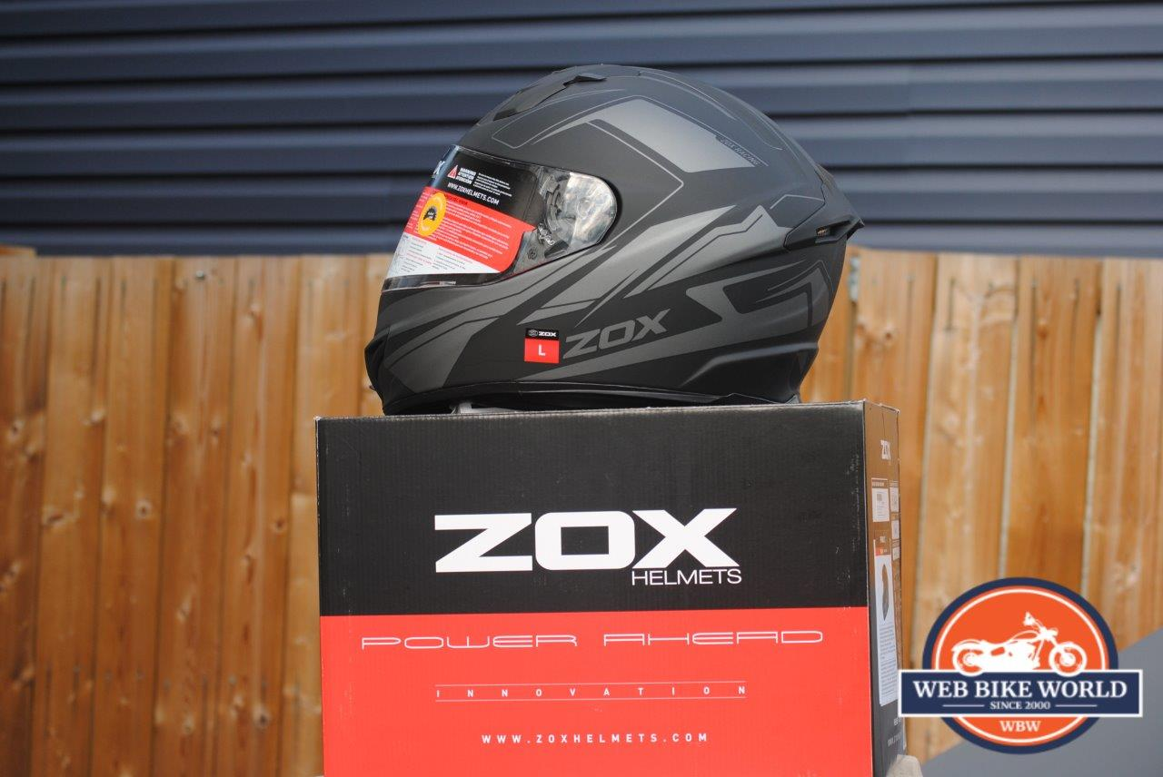 ZOX Primo C Track Helmet on top of ZOX Box