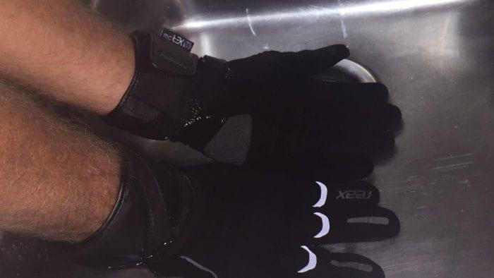 REAX Ridge Waterproof Gloves undergoing a waterproof test in sink