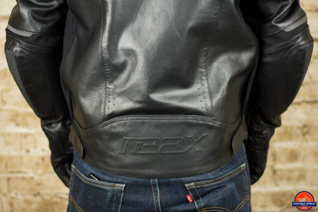 REAX Jackson Riding Jacket Closeup of Lower End and Logo