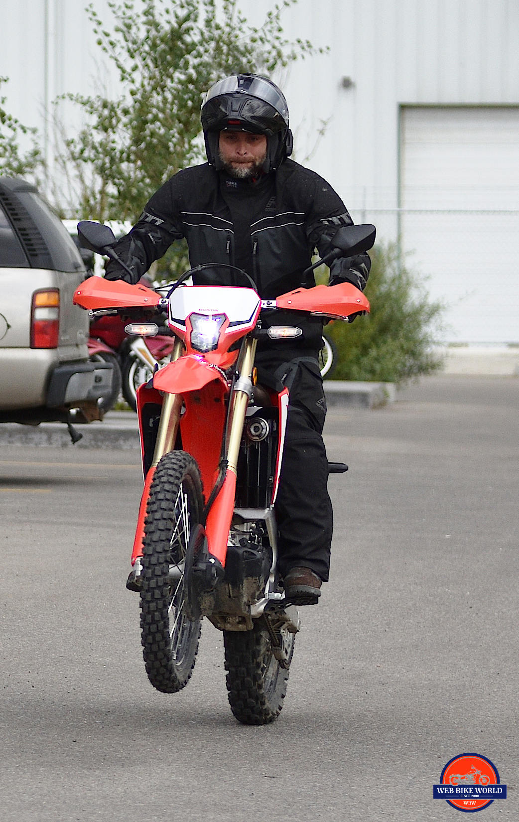 Popping a wheelie on a 2019 Honda CRF450L.